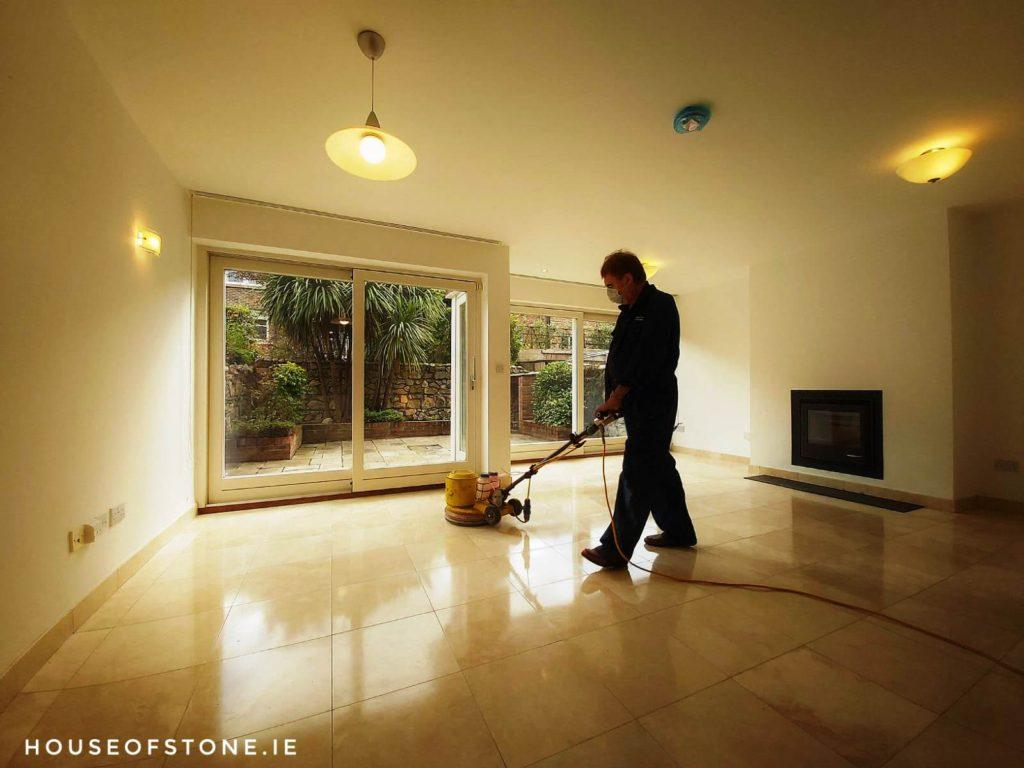 Man Polishing Marble Floor